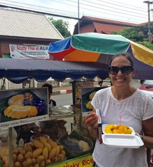 ICS K3 Learning Assistant in Thailand with food cart eating sticky rice and mango