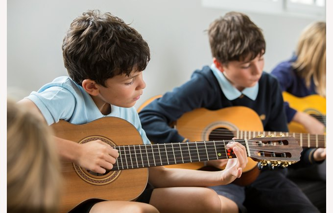 Primary students and guitars