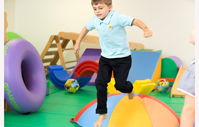 EYFS student playing in gymboree room