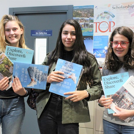 Spanish university fair 2019 girls with ESADE brochure grades