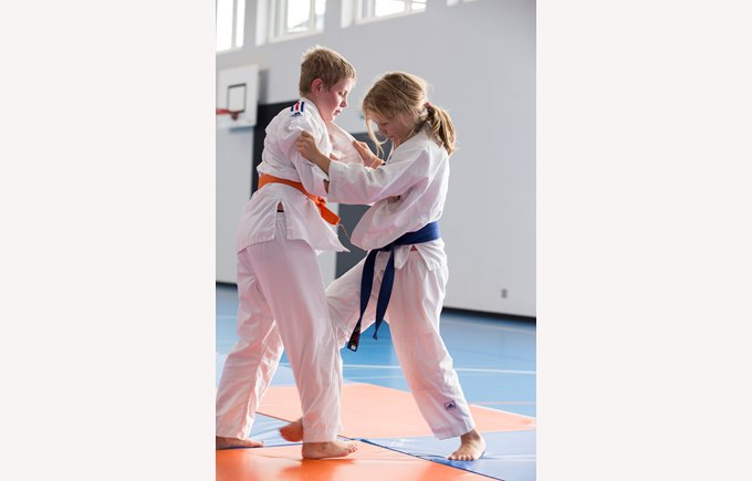 Boy and Girl doing Judo