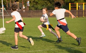 Students playing tag rugby