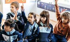 global learning signpost Primary library hands raised
