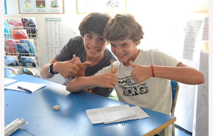 Two boys having fun learning English at Summer School