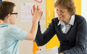 Alison high-fiving a student