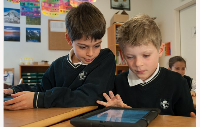 Students working on a iPad