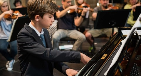PBIS student plays piano with Prague Philharmonic