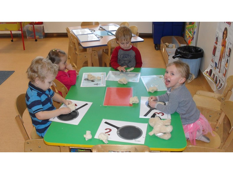 Nursery children with numbers activity