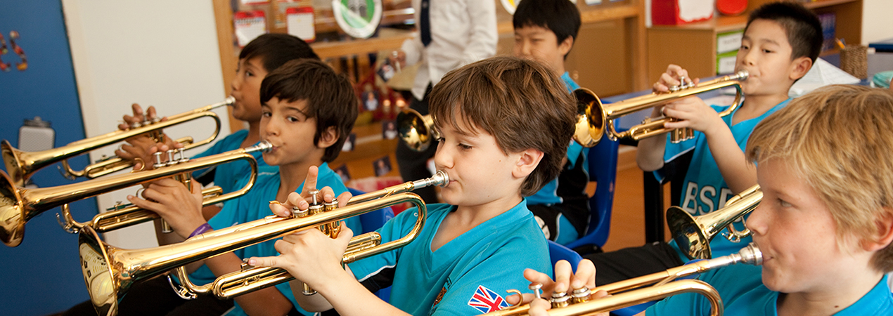 Primary students playing trumpets
