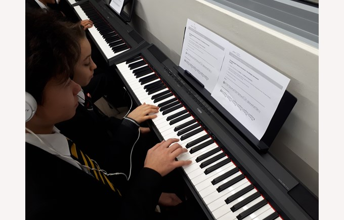 Students play the piano