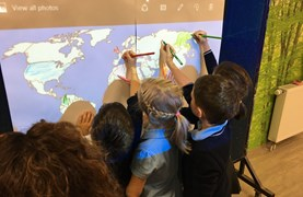 Students colouring the world map