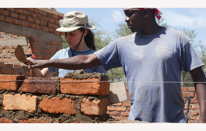 Tanzania experience ICS students learn how to lay bricks to construct houses