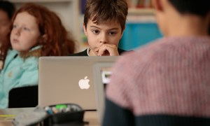 Boy looking at laptop