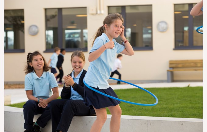 Primary girls hulla hooping