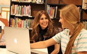Clara Head of Counselling with Secondary student and computer