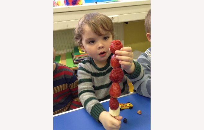boy with strawberries
