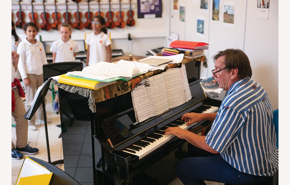 Teacher playing piano