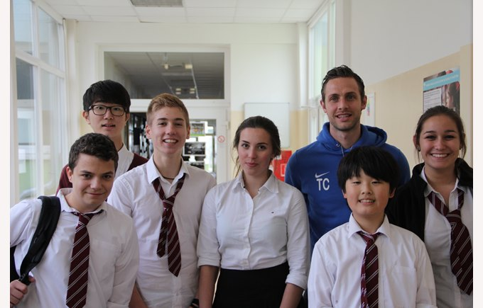 Students in uniform with PE teacher