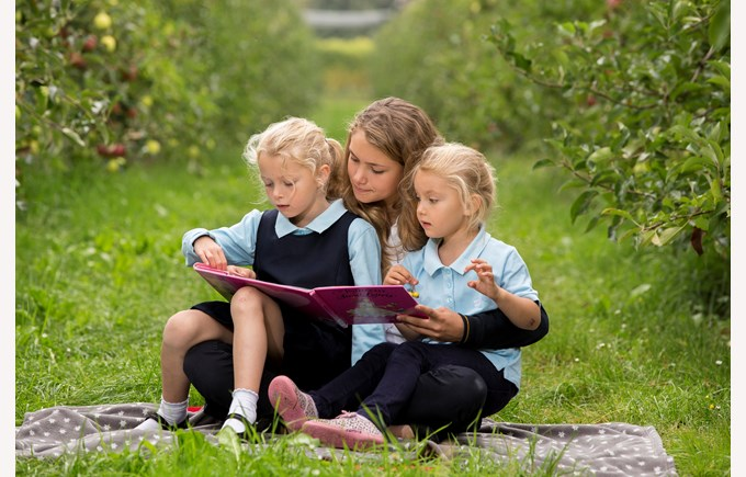 Three sisters reading a book the apple orchard
