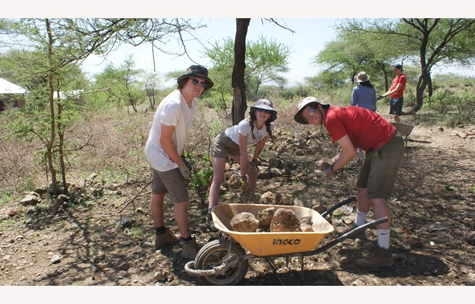 ICS Students prepare the ground to build houses in Tanzania, part of the Global Campus initiative