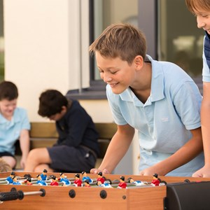 MYP boy students playing foosball