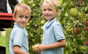 Two primary students in orchard