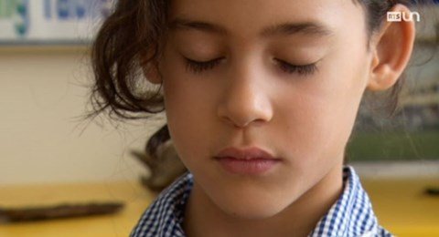 A primary girl practicing mindfulness