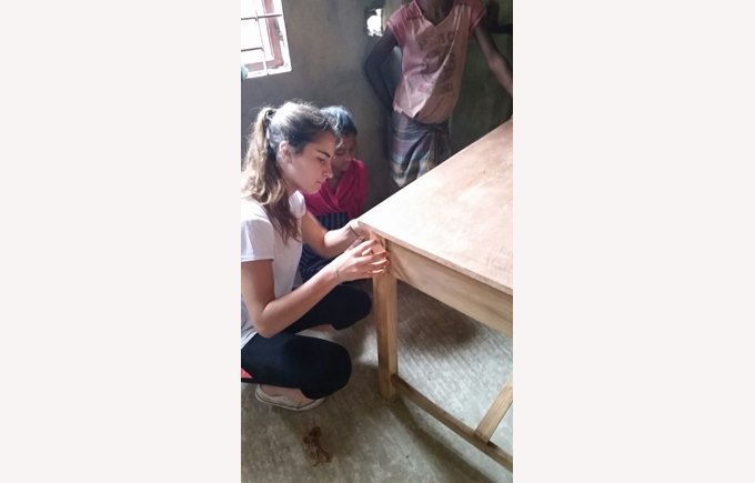 ICS students helped to mend furniture for the school in Bangladesh