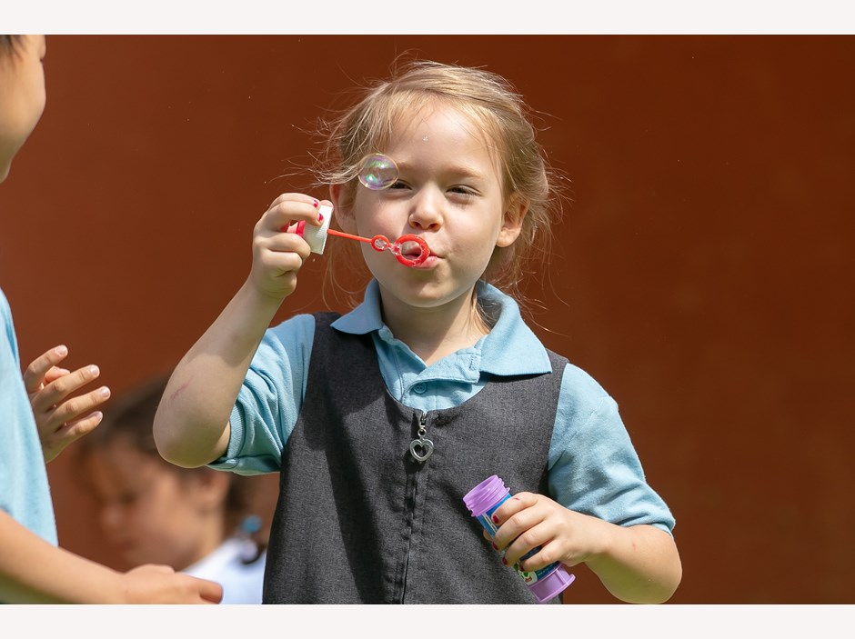 BISB Girl Blowing Bubbles