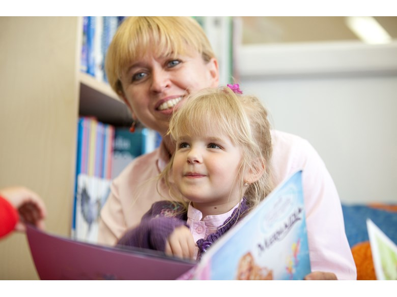 teacher reading book to child