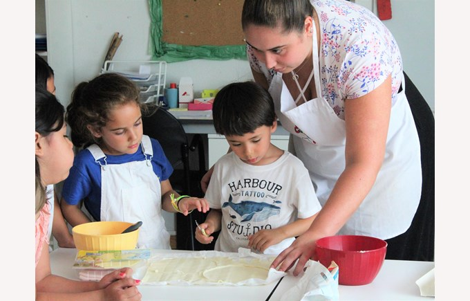 ICS Summer Camps Campamentos de Verano cooking class apron dough