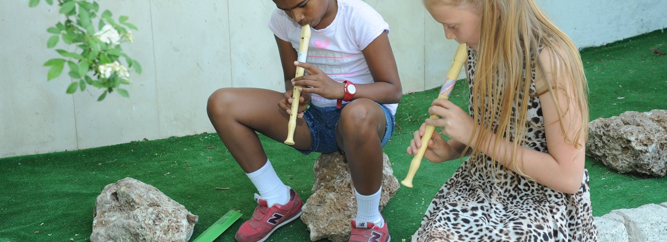 Primary Students Playing Recorders in the Gardens