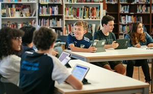 Students in library on their tablets
