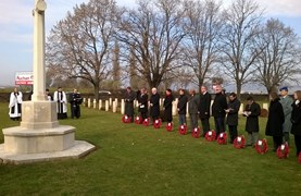 Students, parents and teachers of BISB braved the cold weather to lay a wreath at the Commonwealth War Cemetery at Solymár, s