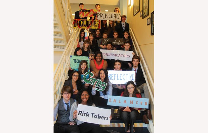 Students pose for a picture on a staircase