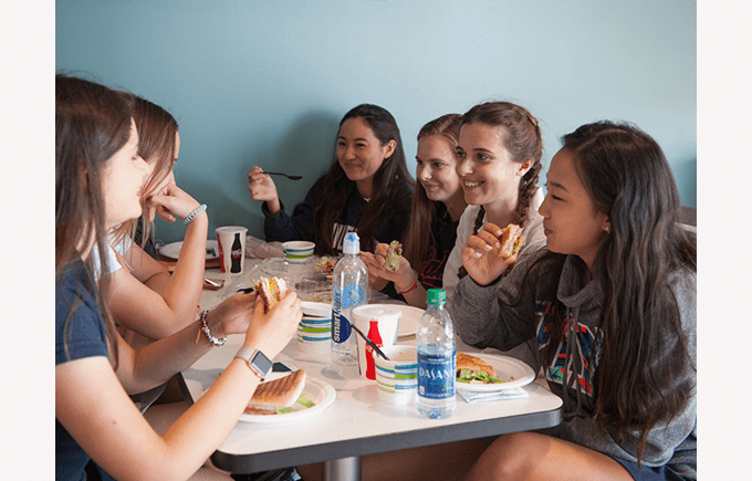 BISW Private British International School of Washington in DC Happy High School Girls Eating Lunch