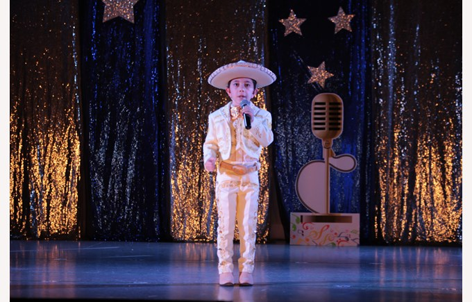 Boy singing at our talent show