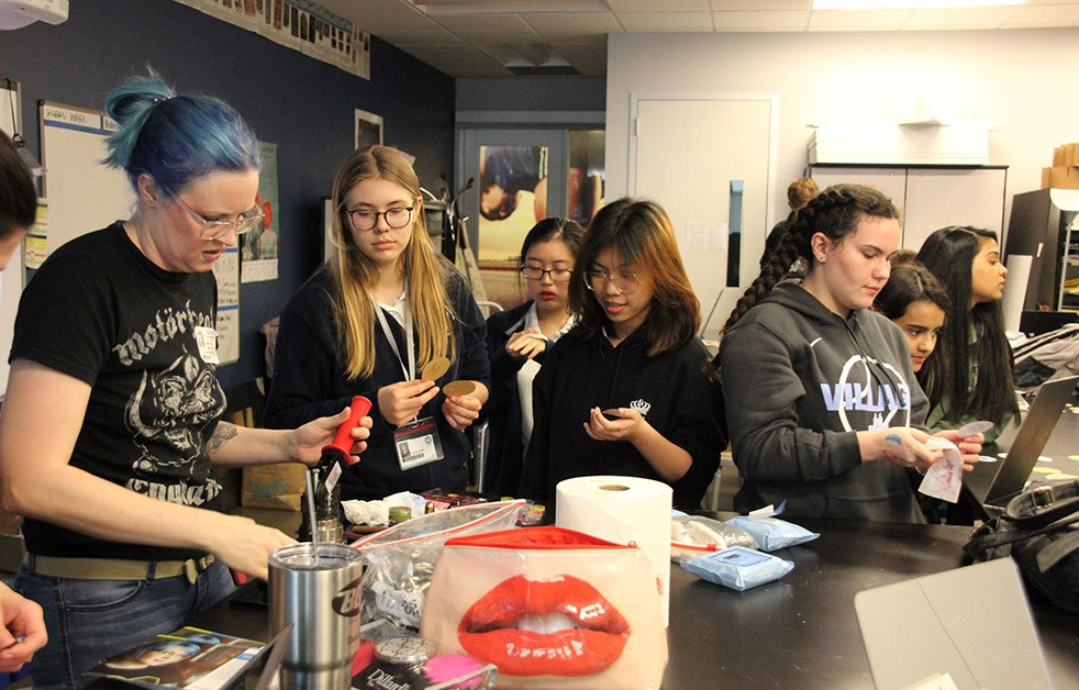 Local art sensation Natalie Irish visits art classes, sharing her technique of creating paintings with lipstick.