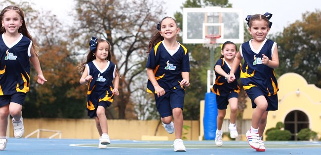 Valle Alto students running at basketball court