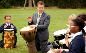 Students learning drums
