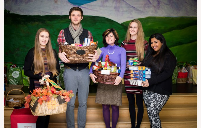 Students giving out Thanksgiving baskets