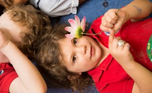Child holding flower