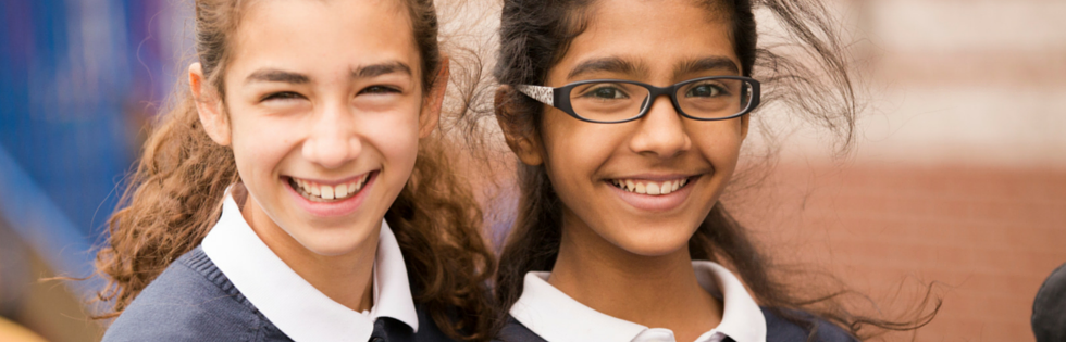 Two girls smile at the British International School of Boston, one of Boston's best private schools.