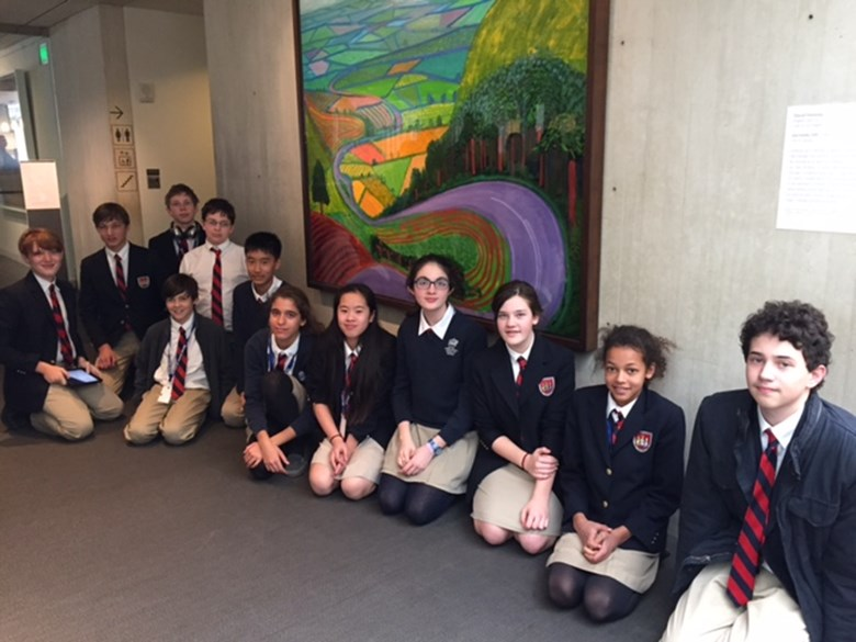 "Students pose in front of David Hockney's ""Garrowby Hill"""