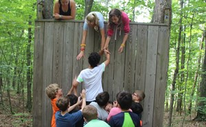 students climb wall