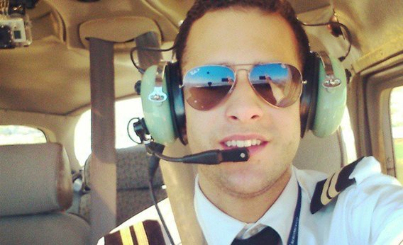 BISB alumni Everardo Ortiz is pictured in the cockpit of an airplane. He recently achieves his goal of becoming a pilot.