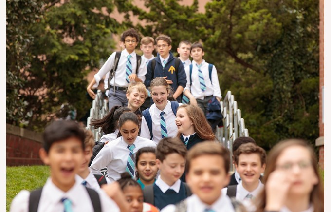 BISW Private British International School of Washington in DC Happy students of all ages walk toward the school