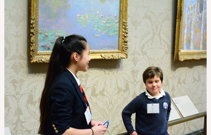 British International School of Boston students and parents enjoy an art exhibit at the Museum of Fine Arts.