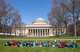 Students on lawn in front of MIT