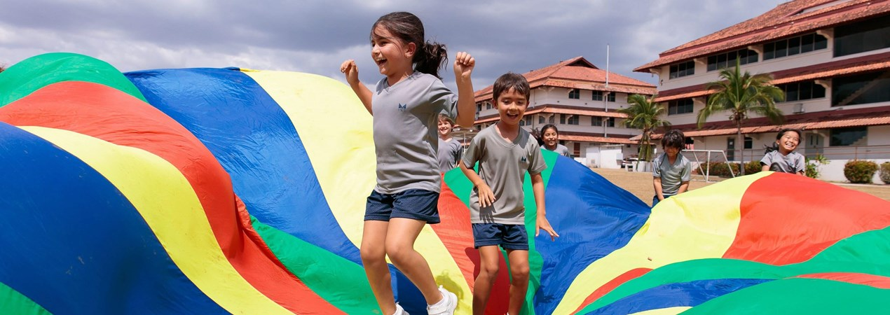 Primary students playing parachute games